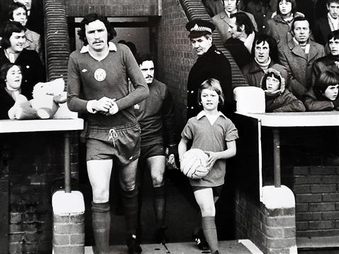 Chris Turner leading Posh out followed by Eric Steele