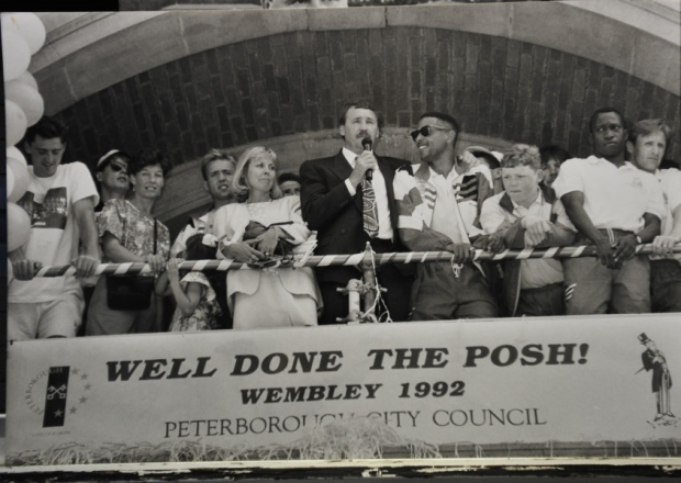 Chris Turner speaking to the crowd outside Peterborough Town Hall with the Wembley winning players