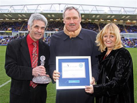 Chris Turner with wife Lynne being presented with the Posh Hall of Fame certificate