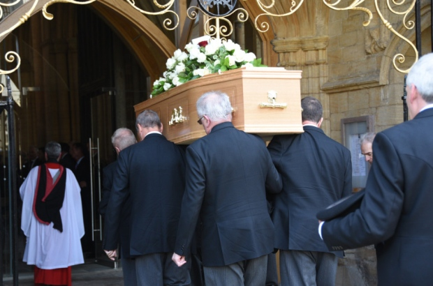 Chris Turners coffin carried into Peterborough Cathedral