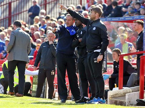 The Posh management trio - Dave Robertson - Aaron McLean - Grant McCann v Barnsley