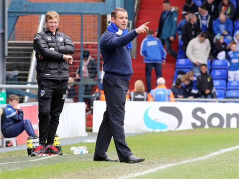 Dave Robertson giving instructions watched by Oldham manager Dean Holden