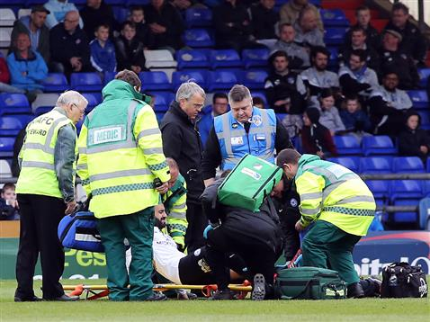 Erhun Oztumer receiving treatment before being carried off v Oldham