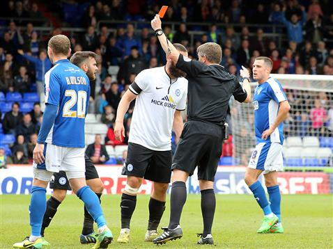 Referee Gary Sutton shows teenage debutant Jon Edwards a red card for a late tackle which missed the Oldham player