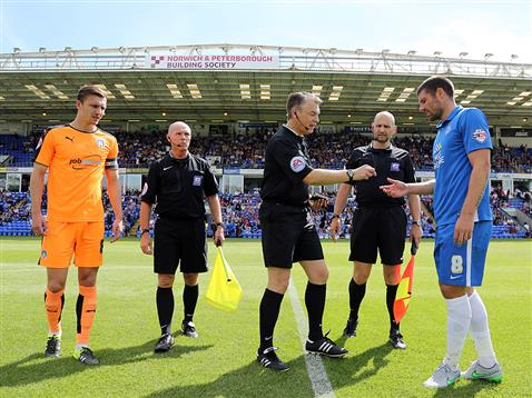Michael Bostwick receives the coin from referee Mark Haywood v Colchester