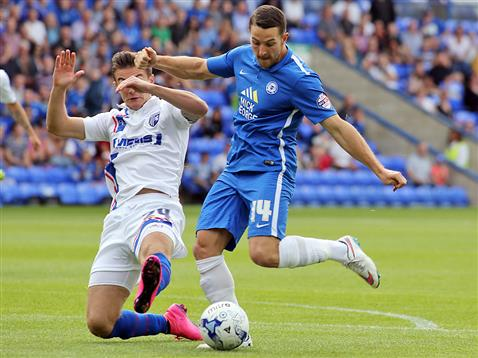 Conor Washington delays taking a shot to allow Gillingham defender to make the block