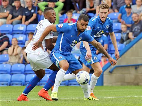 Kyle Vassell shields the ball v Gillingham