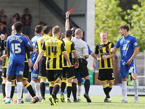 Referee Graham Salisbury sends off Gaby Zakuani v Burton