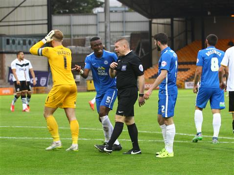 Ben Alnwick cant believe referee Richard Clark awarded a penalty for Port Vale as Gaby Zakuani talks to the ref