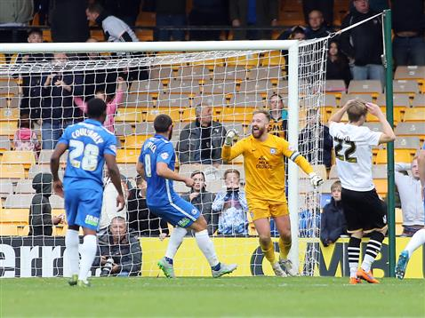 Ben Alnwick celebrates as the penalty hits the bar then his head before going out for a corner v Port Vale