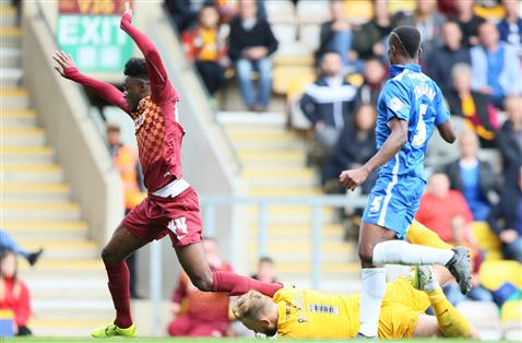 Ben Alnwick saves at the feet of a Bradford player watched by Gaby Zakuani