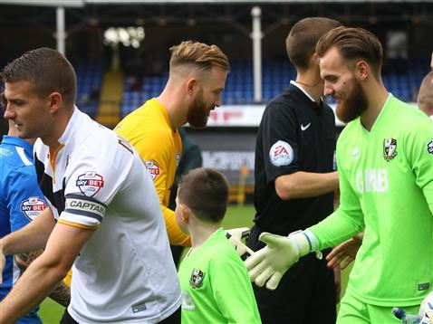 Ben Alnwick shakes brother Jak Alnwicks hand
