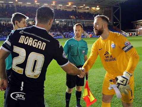 Ben Alnwick shakes hands with Craig Morgan in front of the match officials