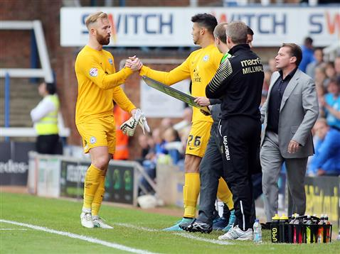 Ben Alnwick shakes hands with debutant goalkeeper Dion-Curtis Henry v Millwall