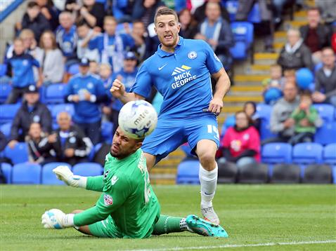Conor Washington watches the ball go past Millwall goalkeeper towards the net