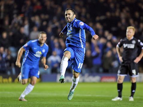 Erhun Oztumer celebrates his tap-in v Wigan