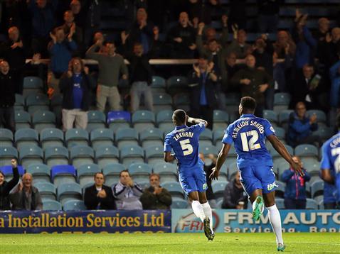 Gaby Zakuani celebrates his first goal v Bury