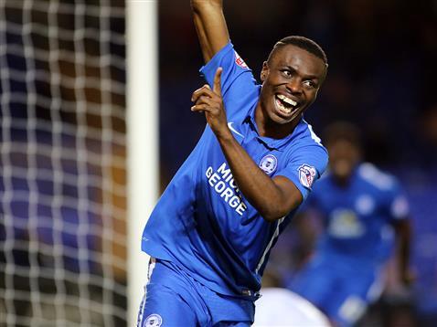 Gaby Zakuani celebrates his second goal v Bury