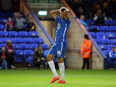 Lee Angol cant believe he missed the goal with just the Bury goalkeeper to beat