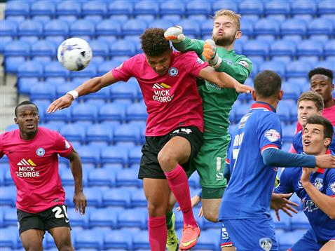 Lee Angol challenges the Oldham keeper on his Football League debut