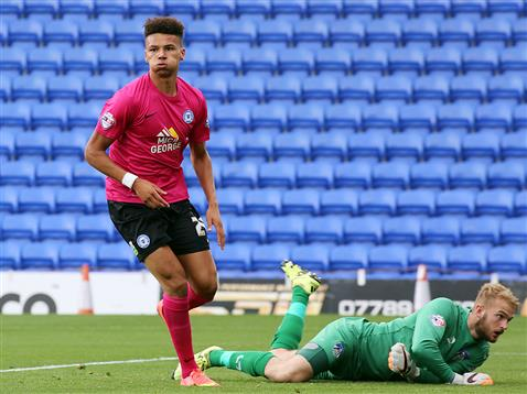 Lee Angol scores his first goal on his debut against Oldham