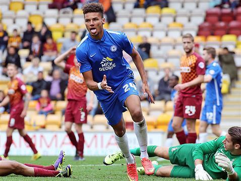 Lee Angol wheels away to celebrate his goal v Bradford