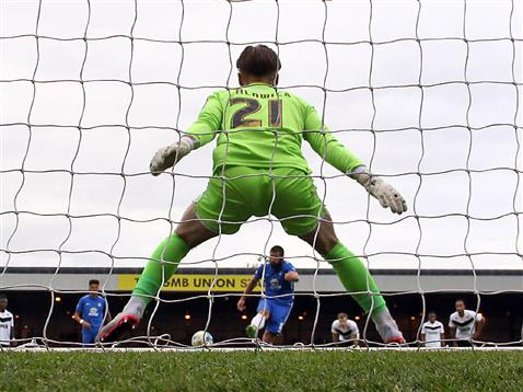 Michael Bostwick about to score a penalty v Jak Alnwick of Port Vale