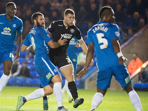Michael Bostwick and Gaby Zakuani watch Yanic Wildschut go close again for Wigan
