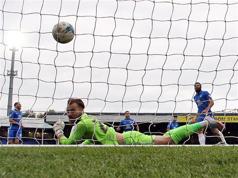Michael Bostwick scores a penalty v Jak Alnwick of Port Vale