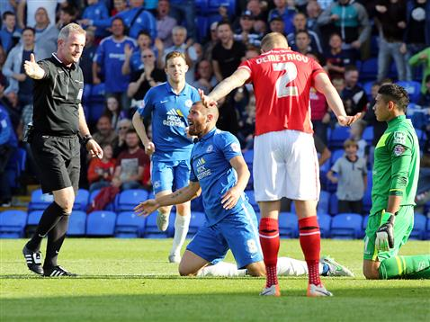 Referee Mark Heywood points to the spot after Michael Bostwick brought down v Walsall