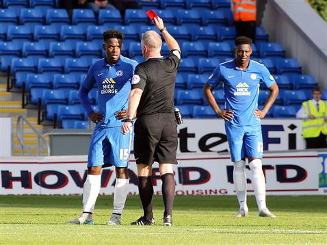 Referee Mark Heywood sends off Jermaine Anderson for throwing a water bottle back to the bench but it went into the crowd by mistake
