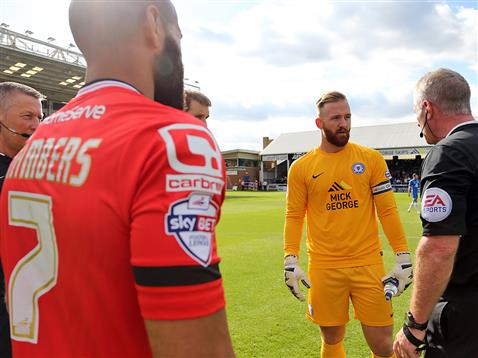 Referee Mark Heywood with Ben Alnwick and the Walsall captain