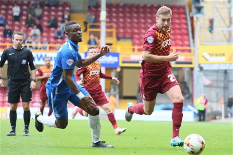 Referee Paul Tierney watches Gaby Zakuani chase after a Bradford player