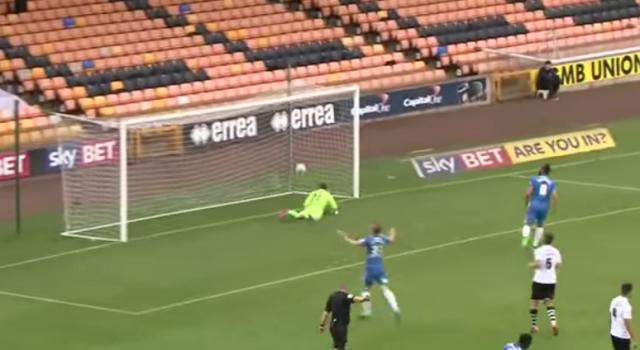 Referee Richard Clark signals a goal for Posh v Port Vale