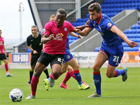 Souleymane Coulibaly watched by referee Seb Stockbridge v Oldham