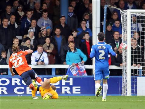 Ben Alnwick beaten by Lutons Craig Mackail-Smith but the ball hits the post