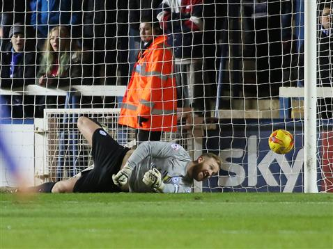 Ben Alnwick just fails to stop Barnsley scoring a penalty
