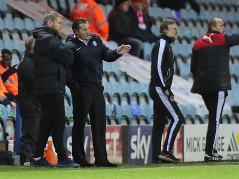 Graham Westley talks with Grant McCann v Fleetwood