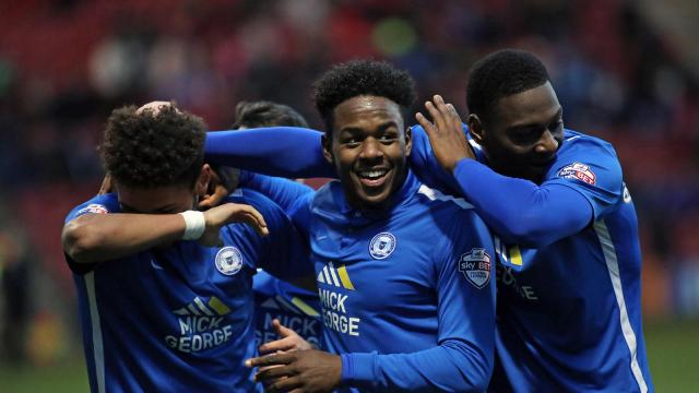 Jermaine Anderson and Ricardo Almeida Santos celebrate Lee Angols goal v Crewe