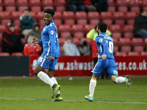 Jermaine Anderson celebrates his first goal with Erhun Oztumer v Crewe