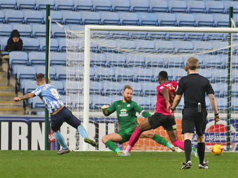 Referee Gavin Ward watches Coventry slot the ball past Ben Alnwick and Ricardo Almeida Santos