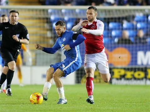 Referee Lee Collins watches Jon Taylor v Fleetwood