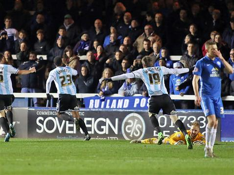 Tyrone Barnett celebrates scoring against Posh in front of London Road end