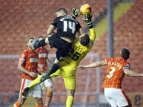 Conor Washington challenges the Blackpool goalkeeper