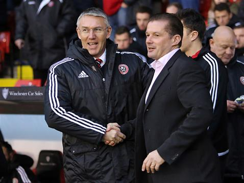 Graham Westley shakes hands with Sheffield United boss Nigel Adkins