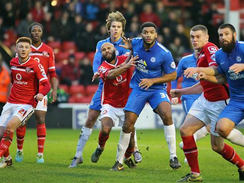 Miles Addison battles during a corner v Walsall