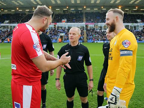 Referee Andy Woolmer with Ben Alnwick and the Chesterfield captain 2