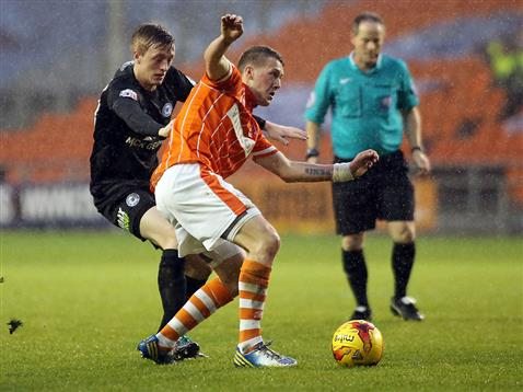 Referee Rob Lewis watches Chris Forrester v Blackpool