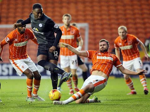 Ricardo Almeida Santos surrounded by Blackpool players