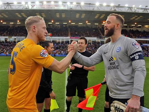 Ben Alnwick shakes hands with Preston captain watched by referee Tony Harrington